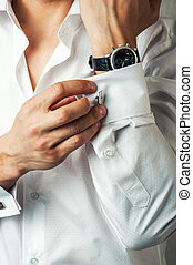 Sexy man buttons cuff-link on French cuffs sleeves luxury...