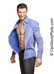 handsome athletic man opens his blue shirt and smiling on white background