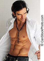 Sexy man - Sexy macho man opening shirt exposing muscular...