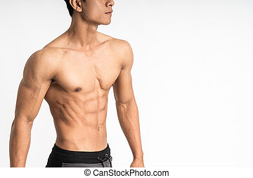sexy man showing muscular abdominal stand facing side