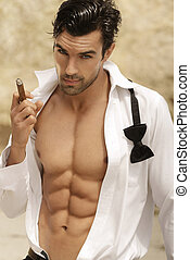 Sexy man - Sexy male model smoking cigar in open formal...