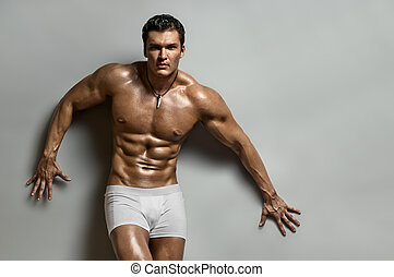 sexy man - the very muscular handsome sexy guy on grey ...