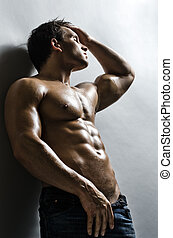 sexy man - the very muscular handsome sexy guy on grey wall...