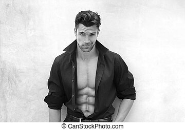 Very sexy male model with open shirt revealing muscular body and nice abs and chest