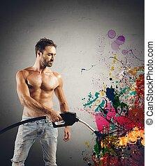 Sexy man with fuel pump