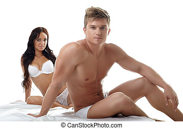 Sexy man with his girlfriend posing in studio