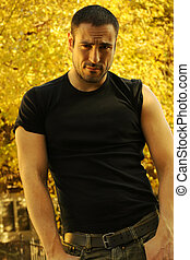 Sexy man with sleeves rolled up - Full body moody portrait ...