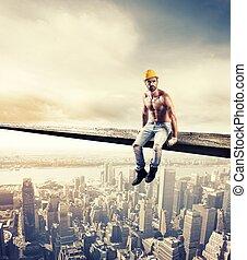 Sexy mason at work over modern cityscape