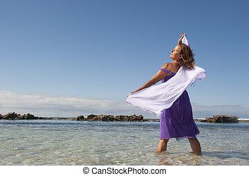 Sexy mature woman beach holiday