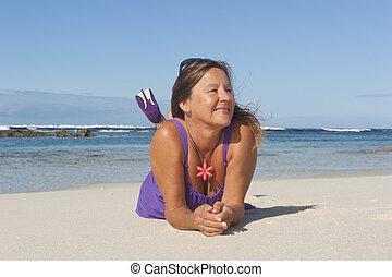 Sexy mature woman beach vacation