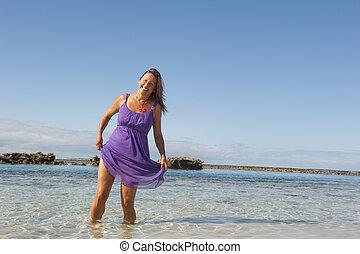 Sexy mature woman ocean