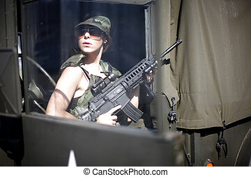 Sexy military woman with rifle.