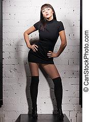 sexy model in black dress