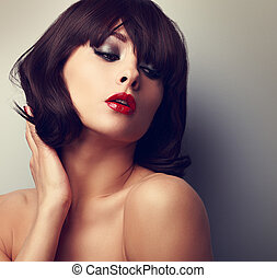 Sexy model posing with black short hairstyle and red lipstick