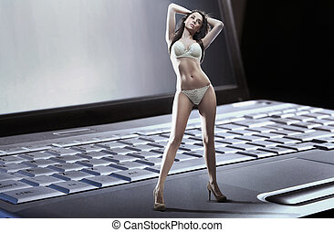 sexy, mujer, llevando, lenceria, posición, n, computador portatil