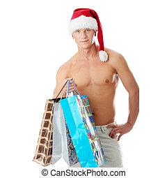 Sexy muscular shirtless man in Santa Claus hat