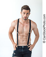 Sexy muscular shirtless man in suspenders