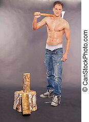 Sexy muscular young man chopping fi - Sexy handsome muscular...