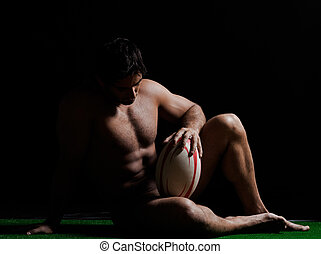 sexy naked rugby man sitting full length
