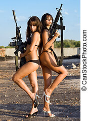 sexy naked women - Two sexy  women posing with rifles