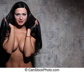 sexy naked young woman in dark studio