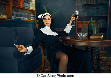 Sexy nun with cigarete and glass of wine - Sexy nun in a ...