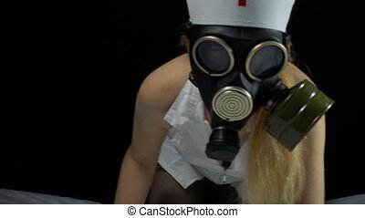 Sexy nurse girl with gas mask in bed - Footage of sexual...