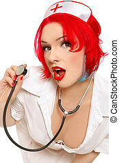 Sexy nurse - Humorous portrait of young redhead woman in...