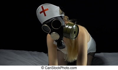 Sexy nurse in gas mask - Footage of sexual young nurse on...