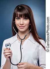Sexy nurse - Sexy rse holding stethoscope on blue background