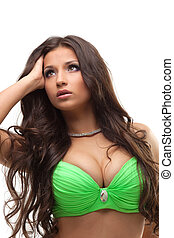 Sexy oriental dancer in green suit with long hair