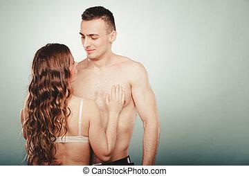 sexy, pareja., medio desnudo, hombre y mujer, en, lingerie.