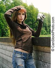 Sexy photographer with retro camera