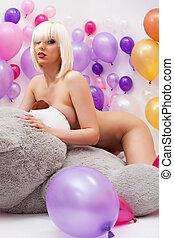 Sexy platinum blonde posing nude in studio