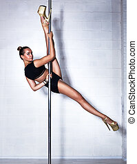 Sexy pole dance woman - Young slim sexy pole dance woman in...