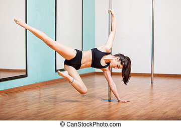 Sexy pole dancer working out