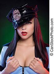 Sexy policewoman. Beautiful young policewoman in uniform...