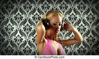 sexy professional gogo lily malibu shot dancing and posing in pink with headphones