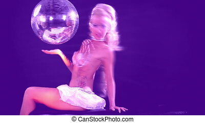 sexy professional gogo lily malibu shot posing and sitting next to a large spinning discoball