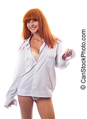 Sexy redheaded woman in a white shirt with epaulets