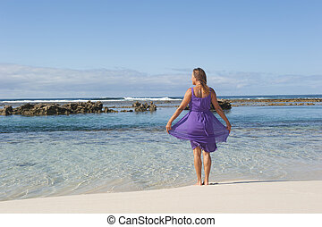 Sexy retired woman beach - Sexy mature woman in pink dress...