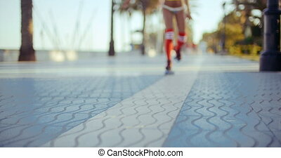 Sexy Roller Girl Skating on Exotic Promenade - Close Up of...
