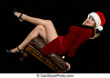 Sexy Santa - Attractive young brunette woman sitting on...