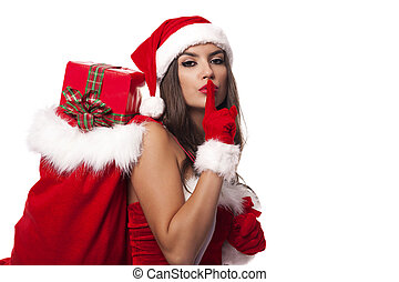 Sexy santa claus woman with christmas sack saying shh