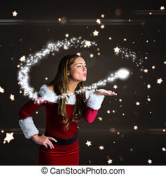 Sexy santa girl blowing a kiss against bright star pattern ...