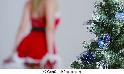 Sexy Santa Girl caresses herself. sex games. holding a whip
