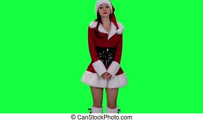 Sexy Santa's helper demonstrates