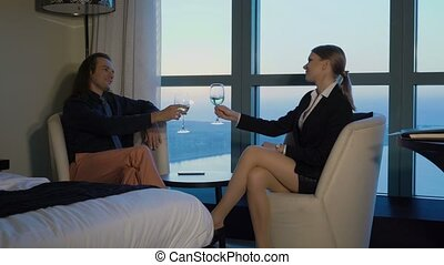 Sexy secretary drinks wine with boss, director at home or...