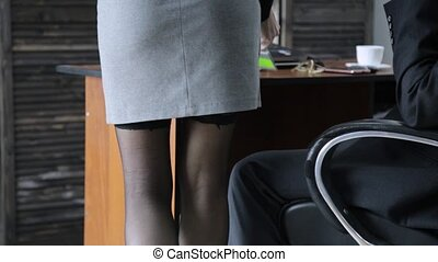 sexy secretary flirting with boss in the workplace. sexual...