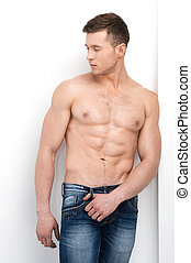 Sexy shirtless macho posing on camera and looking away....